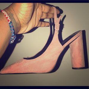 "Pink, round thick 4"" heel pair of pumps"